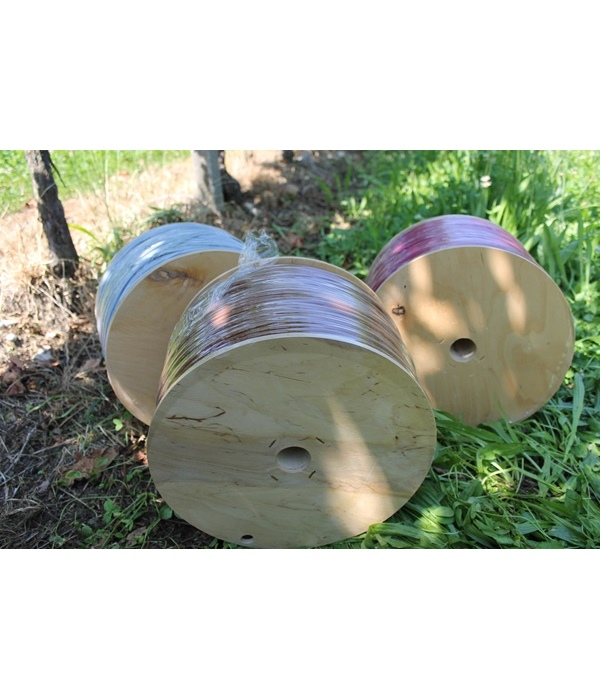 PVC agricultural pipe on wood reel